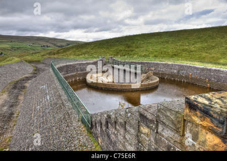 The entrance to the spillaway at Burnhope Reservoir. - Stock Image