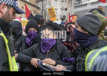 London, UK. 9th Dec, 2018. People wait to march at the start of the united counter demonstration by anti-fascists in opposition to Tommy Robinson's fascist pro-Brexit march. The march which included both remain and leave supporting anti-fascists gathered at the BBC to to to a rally at Downing St. Police had issued conditions on both events designed to keep the two groups well apart. Credit: Peter Marshall/Alamy Live News - Stock Image