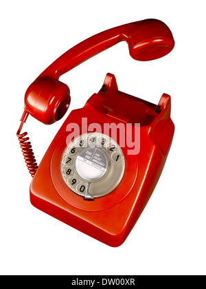 A cut out shot of a old fashioned red telephone. - Stock Image