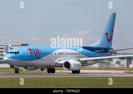 TUI Airways Boeing 737-800 aircraft, registration G-TAWV, preparing for take off from Manchester Airport, England. - Stock Image