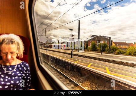Sitting on train, Grantham train station, Grantham train station Lincolnshire, woman on a train, sat on train, pulling - Stock Image