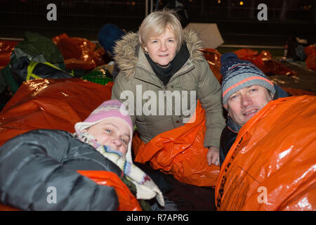 Aberdeen, UK. 8th Dec 2018. Sleep in the Park. Chair of Aberdeen, UK. 8th Dec 2018. city council Angela Scott with councillorsJenny Laing and Douglas Lumsden bed down for the night in Duthie Park.   Credit Paul Glendell Credit: Paul Glendell/Alamy Live News - Stock Image