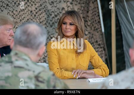U.S. President Donald Trump and First Lady Melania Trump speaks to senior military leaders and answers questions from the media during a surprise visit to al-Asad Air Base December 26, 2018 in Al Anbar, Iraq. The president and the first lady spent about three hours on Boxing Day at Al Asad, located in western Iraq, their first trip to visit troops overseas since taking office. - Stock Image