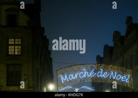 Illuminated sign advertising an outdoor Christmas market in French - Stock Image