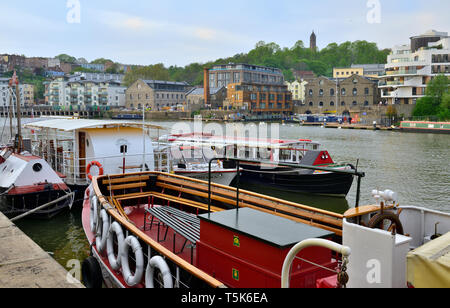 Bristol floating harbour with sightseeing and ferry boats background of new build apartment buildings - Stock Image