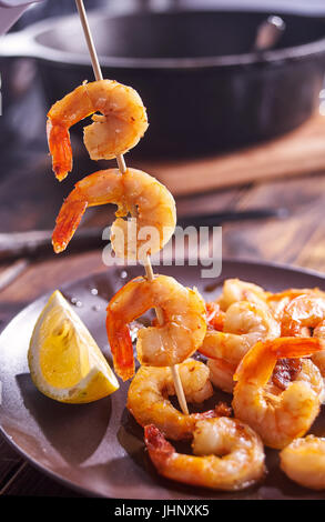 Shrimps on stick for barbeque. - Stock Image