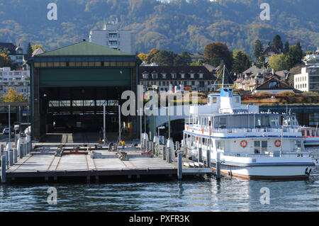 The wharft of the Lake Zürich cruise ships in Wollishofen - Stock Image