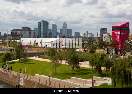 Canary Wharf buildings beyond Megastore and lawns at Olympic Park, London 2012 Olympic Games site, Stratford London - Stock Image