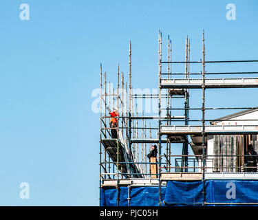 Gosford, New South Wales, Australia - August 3. 2018: Construction and building progress update 112. Workmen on new home units building site at 47 Bea - Stock Image