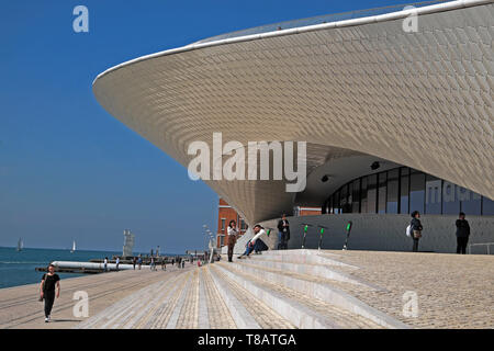 Visitors outside MAAT building Museum of Art Architecture and Technology on the Tagus river waterfront in Belem Lisbon Portugal Europe EU KATHY DEWITT - Stock Image