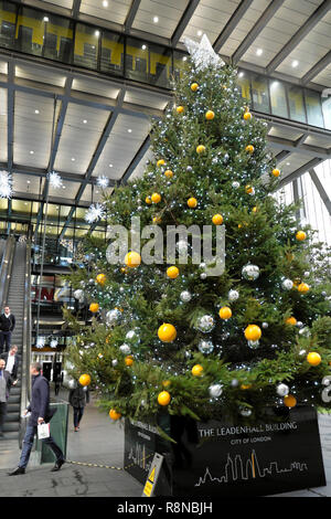 Vertical view of large Christmas tree with bauble decorations outside the Leadenhall office building in the City of London UK  KATHY DEWITT - Stock Image