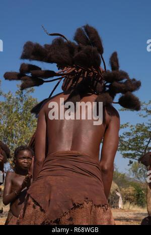 Himba tribe young woman dancing, Cunene Province, Oncocua, Angola - Stock Image