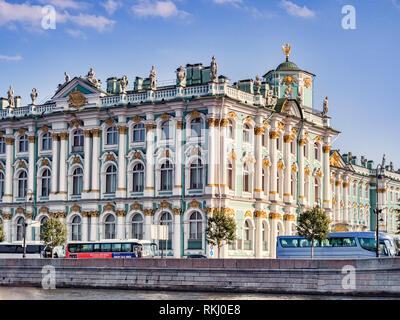19 September 2018: St Petersburg, Russia - The Winter Palace and State Hermitage Museum, on the Neva Embankment, and tour coaches parked outside. - Stock Image