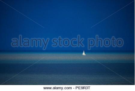 Yacht on blue sea. 2000 Yacht on a blue sea Seen off Suffolk coast in England. - Stock Image