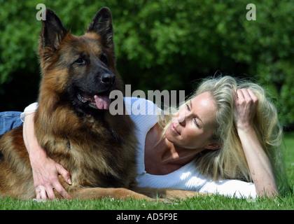 German shepherd and woman - Stock Image