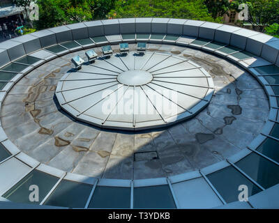 Circular metal and glass canopy of the Carlton Hotel Singapore. - Stock Image