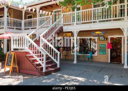 TAOS, NM, USA-8 JULY 18:   A stairway to upper-floor shops on Bent Street, in Taos. - Stock Image