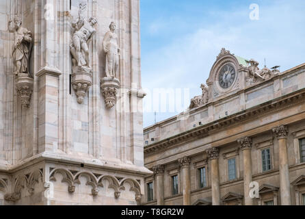 Architectural details of Cathedral (Duomo) and Royal Palace, Piazza del Duomo, Milan, Italy. - Stock Image