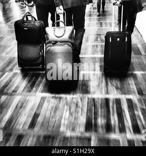 Business travellers departing at an airport - Stock Image