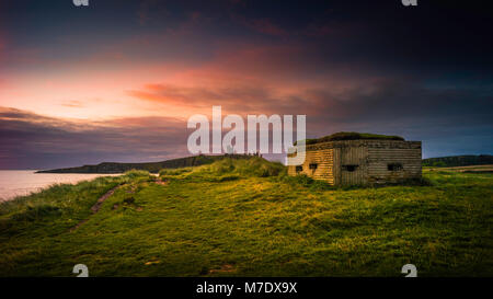 Defensive structures from the middle ages and WW2 on the Northumberland coast. - Stock Image