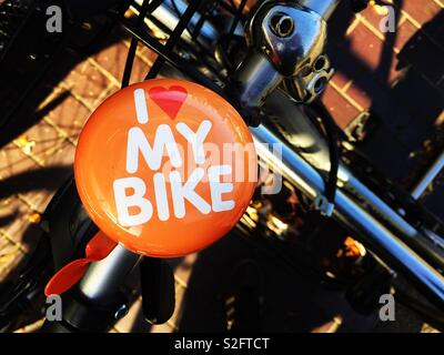A bell on a bike with a message saying I love my bike - Stock Image