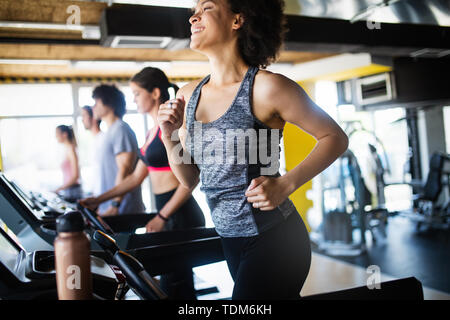 Group of healthy fit people at the gym exercising - Stock Image