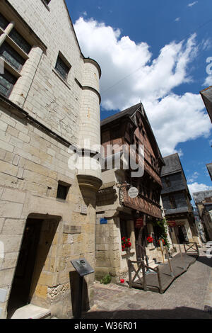 Chinon, France. Picturesque street view of Chinon's Rue Voltaire with the Carroi Museum in the foreground. - Stock Image