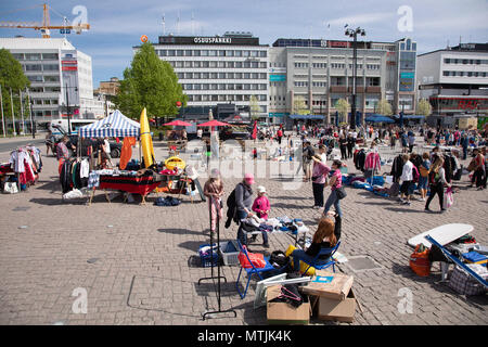 Cobblestoned Kuopio market place is right in the city center. On four occasions each summer, anyone may rent a spot for flea market sales. - Stock Image