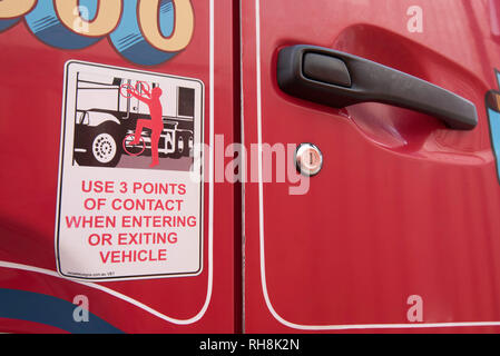 A safety sticker warning a truck driver to use 3 points of contact when entering or exiting the cab of the truck - Stock Image