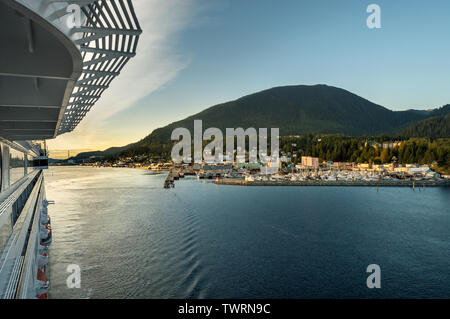 Sept. 17, 2018 - Ketchikan, AK: View of city from upper deck of The Volendam cruise ship as it leaves port in late afternoon sunlight. - Stock Image