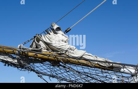 Furled jib sail on bowsprit of S/V Denis Sullivan, Milwaukee, WI Discovery World schooner - Stock Image