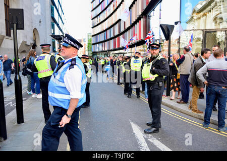London, England, UK. Police officers policing a crowd outside the Old Bailey, May 2019, as Tommy Robinson is sent for retrial on contempt charges - Stock Image