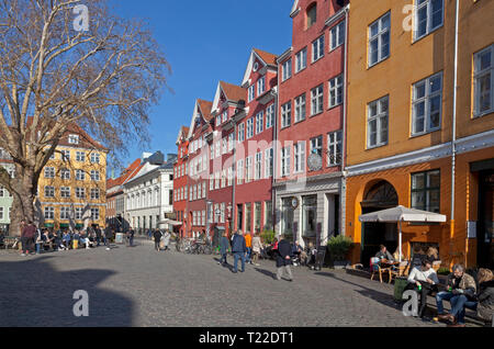 Ambience in Gråbrødretorv, Gråbrødre Square, close to Strøget in central Copenhagen. People are enjoying refreshments on a warm and sunny spring day. - Stock Image
