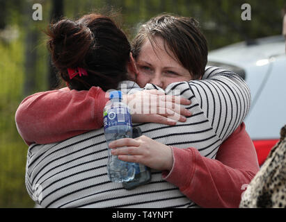 Sara Canning (right), the partner of 29-year-old journalist Lyra McKee at a rally in Londonderry, Northern Ireland, following her death last night after guns were fired and petrol bombs were thrown in what police are treating as a 'terrorist incident'. - Stock Image