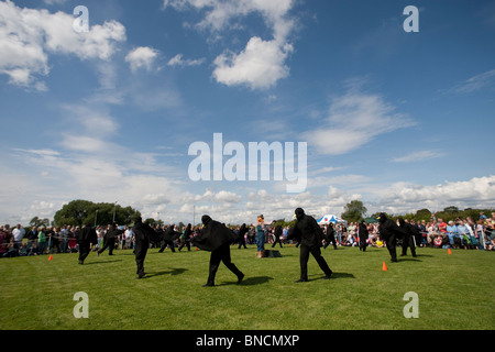 The Crow Dance at the village fair in Moulton, Cheshire. - Stock Image
