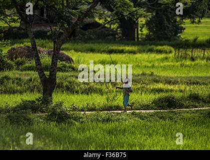 Boy running, Myanmar - Stock Image