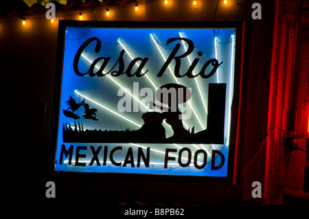Mexican food neon sign at night bright colors San Antonio Texas tx dark background local food cuisine - Stock Image