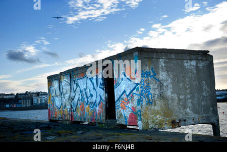 Derelict building on the breakwater at Granton, Newhaven, Leith near Edinburgh - Stock Image