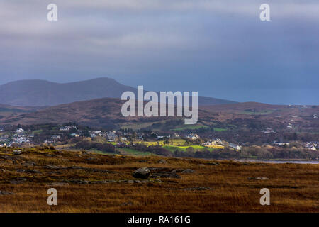 Ardara, County Donegal, Ireland. 29th December 2018. Winter sunlight illuminates houses in the village on a gloomy but warm day for this time of year. Credit: Richard Wayman/Alamy Live News - Stock Image