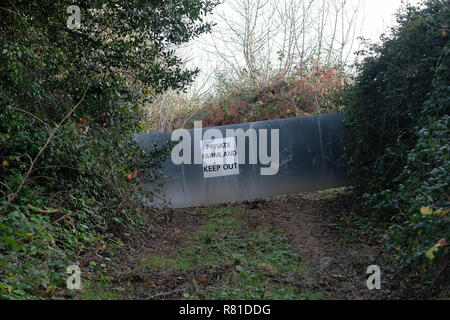 A steel barrier protecting farmland in Penryn, Cornwall. - Stock Image