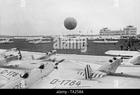 Several aircrafts on display at the airfield on the opening ceremony of the new Munich airport Oberwiesenfeld. - Stock Image