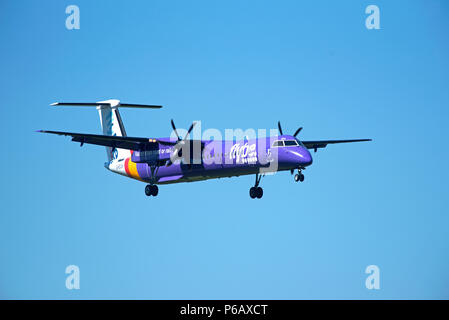 Flybe Dash 8 -400Q Passenger aircraftT approaching Inverness airport in the Scottish Highlands ready for landing. - Stock Image