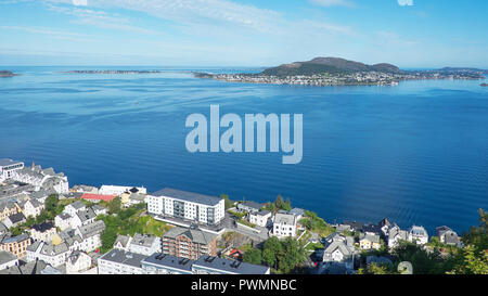 Panoramic north-west views of the town of Alesund, Norway, from partway up Aksla, a hill that overlooks the town and the surrounding fjord - Stock Image