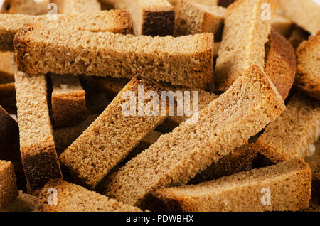 Pile of seasoned bread croutons sticks as background - Stock Image