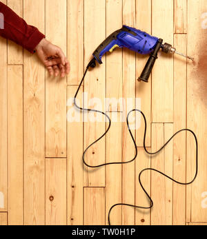 Tradesman or builder suffering an electrical accident - Stock Image