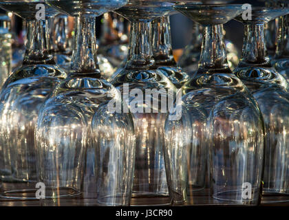 Reflection patterns on upside down water goblets cool tone - Stock Image