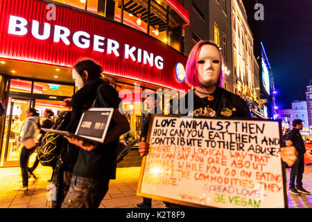 Vegan protesters Leicester Square London, Vegan protesters outside Burger King, Vegan protesters outside Burger King Leicester Square London, UK, - Stock Image