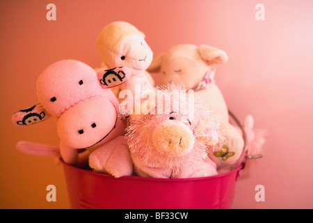 Close-up of toys in a container - Stock Image