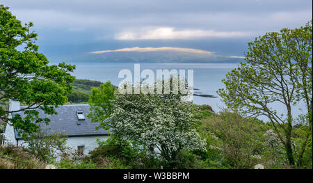View across Sound of Sleat with moody sky, Ardvasar, Isle of Skye, Scottish Highlands, Scotland, UK - Stock Image
