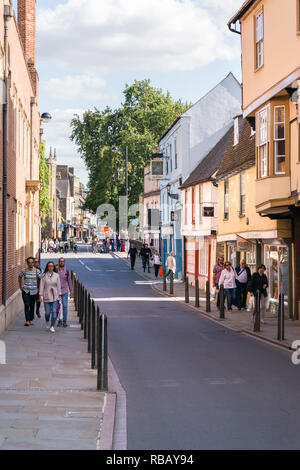 People walking along Bridge Street past shops on a sunny Summer afternoon, Cambridge, UK - Stock Image